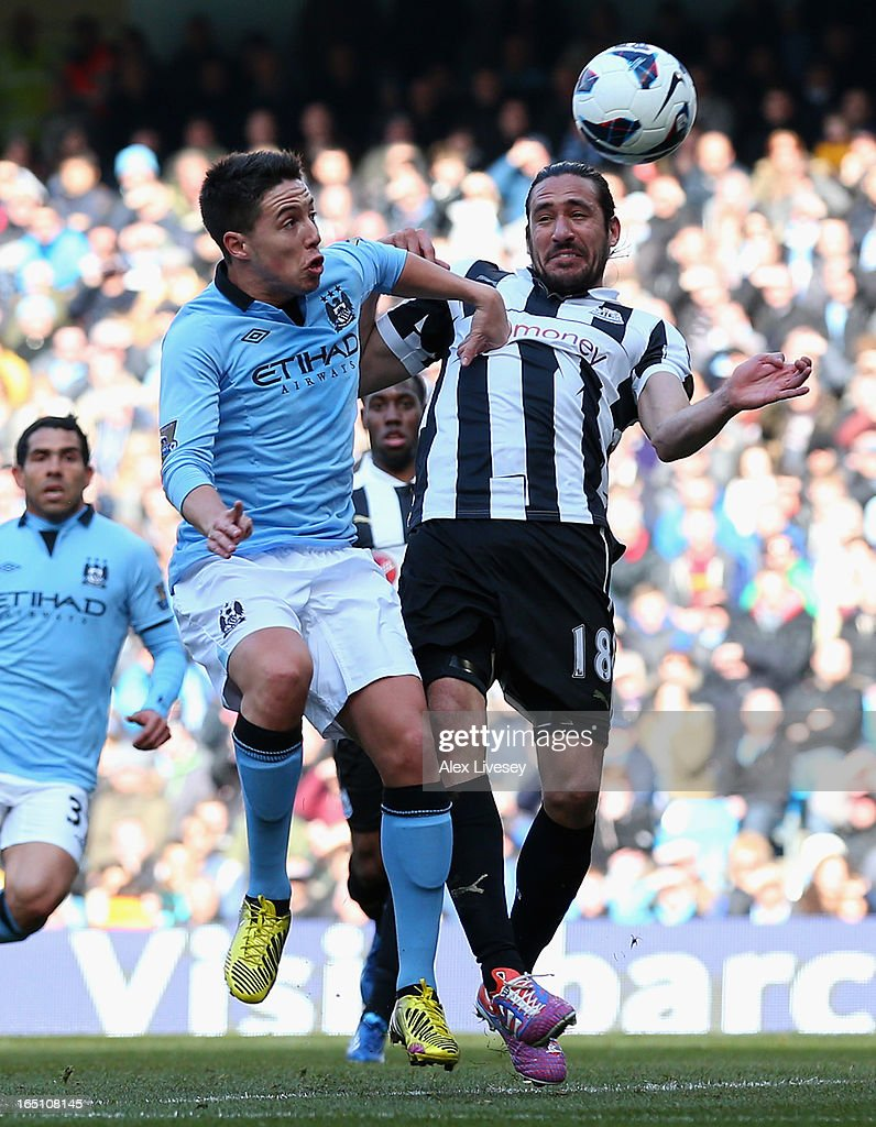 <a gi-track='captionPersonalityLinkClicked' href=/galleries/search?phrase=Samir+Nasri&family=editorial&specificpeople=648450 ng-click='$event.stopPropagation()'>Samir Nasri</a> of Manchester City competes with Jonas Gutierrez of Newcastle United during the Barclays Premier League match between Manchester City and Newcastle United at the Etihad Stadium on March 30, 2013 in Manchester, England.