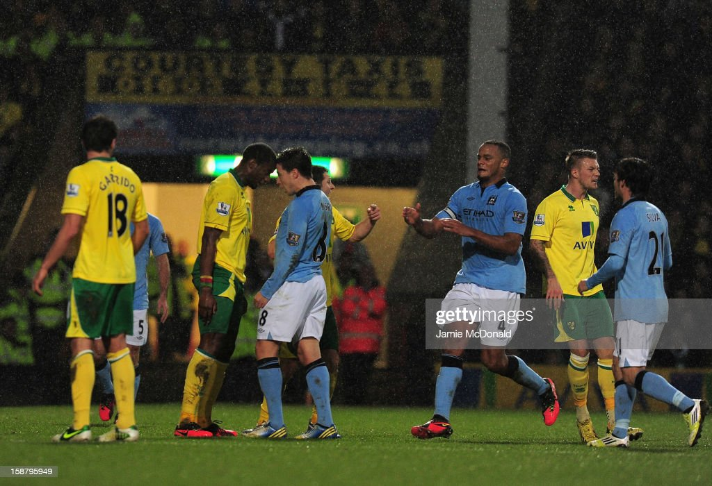 Samir Nasri of Manchester City (R) head butts Sebastien Bassong of Norwich City during the Barclays Premier League match between Norwich City and Manchester City at Carrow Road on December 29, 2012 in Norwich, England.