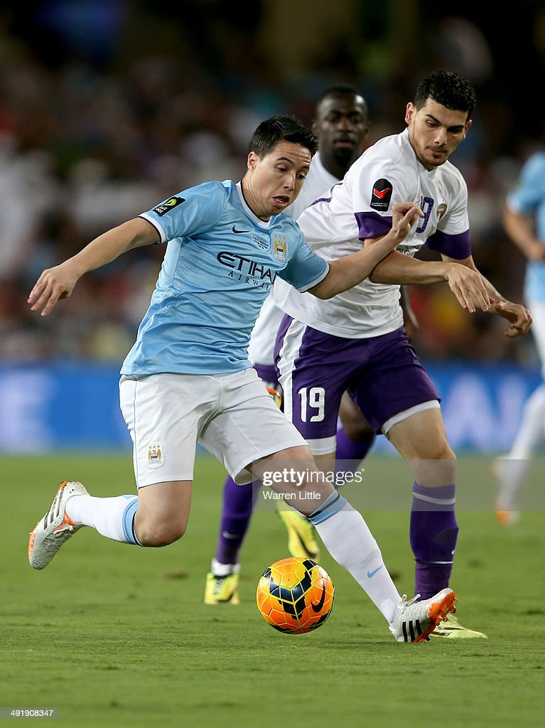 <a gi-track='captionPersonalityLinkClicked' href=/galleries/search?phrase=Samir+Nasri&family=editorial&specificpeople=648450 ng-click='$event.stopPropagation()'>Samir Nasri</a> of Manchester City in action during the friendly match between Al Ain and Manchester City at Hazza bin Zayed Stadium on May 15, 2014 in Al Ain, United Arab Emirates.