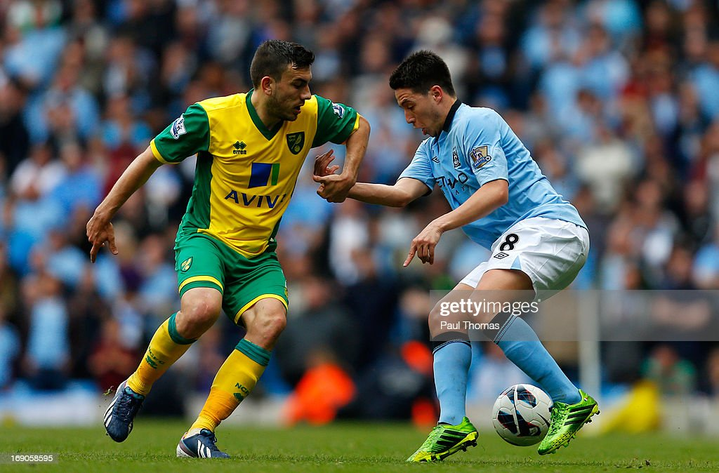 <a gi-track='captionPersonalityLinkClicked' href=/galleries/search?phrase=Samir+Nasri&family=editorial&specificpeople=648450 ng-click='$event.stopPropagation()'>Samir Nasri</a> (R) of Manchester City in action with <a gi-track='captionPersonalityLinkClicked' href=/galleries/search?phrase=Robert+Snodgrass&family=editorial&specificpeople=5488953 ng-click='$event.stopPropagation()'>Robert Snodgrass</a> of Norwich during the Barclays Premier League match between Manchester City and Norwich City at the Etihad Stadium on May 19, 2013 in Manchester, England.