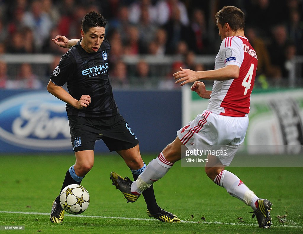 <a gi-track='captionPersonalityLinkClicked' href=/galleries/search?phrase=Samir+Nasri&family=editorial&specificpeople=648450 ng-click='$event.stopPropagation()'>Samir Nasri</a> of Manchester City is challenged by <a gi-track='captionPersonalityLinkClicked' href=/galleries/search?phrase=Niklas+Moisander&family=editorial&specificpeople=5522239 ng-click='$event.stopPropagation()'>Niklas Moisander</a> of Ajax during the UEFA Champions League Group D match between AFC Ajax v Manchester City at the Amsterdam Arena on October 24, 2012 in Amsterdam, Netherlands.