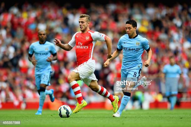 Samir Nasri of Manchester City pursues Jack Wilshere of Arsenal during the Barclays Premier League match between Arsenal and Manchester City at...