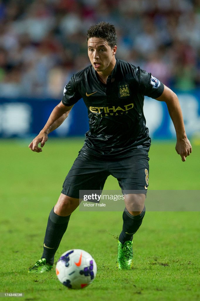 <a gi-track='captionPersonalityLinkClicked' href=/galleries/search?phrase=Samir+Nasri&family=editorial&specificpeople=648450 ng-click='$event.stopPropagation()'>Samir Nasri</a> of Manchester City runs with the ball during the Barclays Asia Trophy Semi Final match between Manchester City and South China at Hong Kong Stadium on July 24, 2013 in So Kon Po, Hong Kong.
