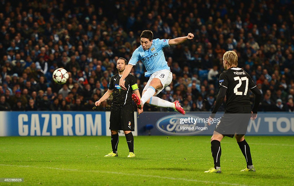 <a gi-track='captionPersonalityLinkClicked' href=/galleries/search?phrase=Samir+Nasri&family=editorial&specificpeople=648450 ng-click='$event.stopPropagation()'>Samir Nasri</a> of Manchester City scores his team's second goal during the UEFA Champions League Group D match between Manchester City and FC Viktoria Plzen at Etihad Stadium on November 27, 2013 in Manchester, England.