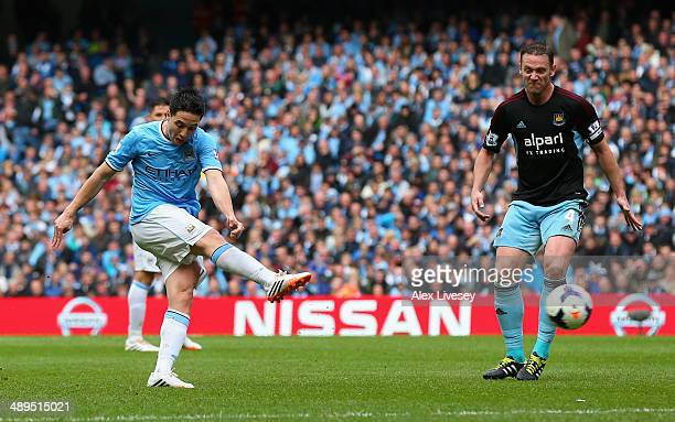 Samir Nasri of Manchester City scores the first goal during the Barclays Premier League match between Manchester City and West Ham United at the...