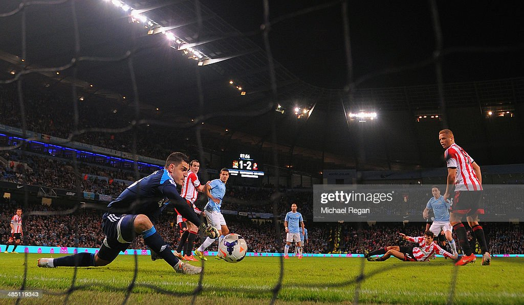 Samir Nasri of Manchester City scores their second goal past Vito Mannone of Sunderland during the Barclays Premier League match between Manchester City and Sunderland at Etihad Stadium on April 16, 2014 in Manchester, England.