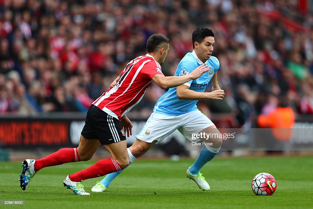 <a gi-track='captionPersonalityLinkClicked' href=/galleries/search?phrase=Samir+Nasri&family=editorial&specificpeople=648450 ng-click='$event.stopPropagation()'>Samir Nasri</a> of Manchester City takes on Dusan Tadic of Southampton during the Barclays Premier League match between Southampton and Manchester City at St Mary's Stadium on May 1, 2016 in Southampton, England.