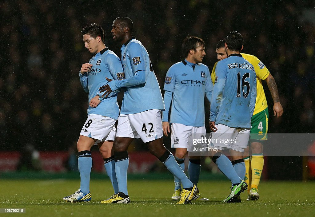 Samir Nasri of Manchester City walks off the pitch after he is shown the red card by referee Mike Jones after he head butts Sebastien Bassong of Norwich City during the Barclays Premier League match between Norwich City and Manchester City at Carrow Road on December 29, 2012 in Norwich, England.