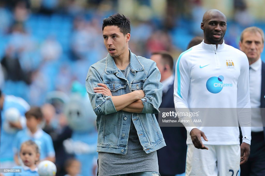 http://media.gettyimages.com/photos/samir-nasri-of-manchester-city-wearing-a-denim-jacket-after-the-picture-id529432288