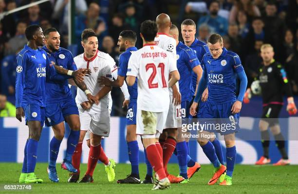 Samir Nasri of Sevilla and Jamie Vardy of Leicester City clash after Nasri was shown a red card during the UEFA Champions League Round of 16 second...