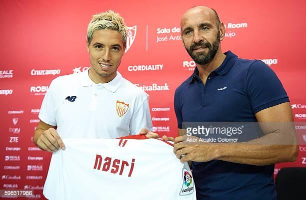Samir Nasri of Sevilla and sports director of Sevilla FC Ramon Rodriguez 'Monchi' during his official presentation at the Estadio Ramon Sanchez...