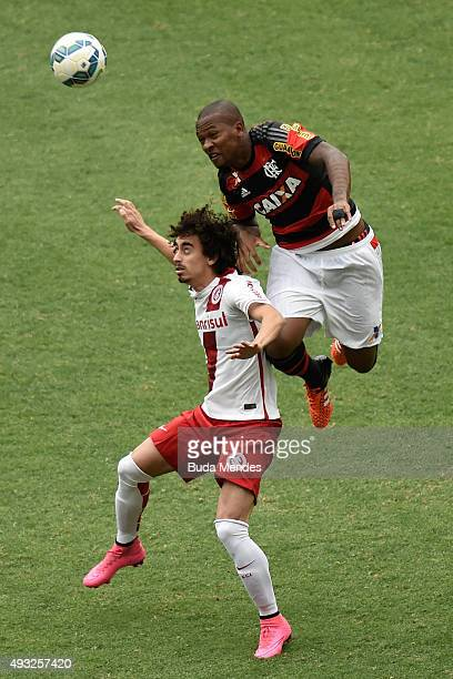 Samir of Flamengo battles for the ball with Valdívia of Internacional during a match between Flamengo and Internacional as part of Brasileirao Series...