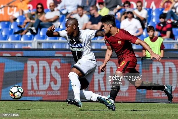 Samir of Udinese is challenged by Diego Perotti of Roma during the Serie A match between Roma and Udinese at Olympic Stadium Roma Italy on 23...