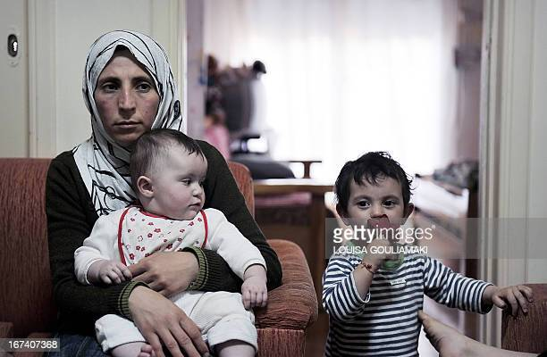 Samira alMassoud holds her fivemonths old daughter Ryan who was born in Greece in their shared apartment in Athens on April 19 2013 'We wanted to...