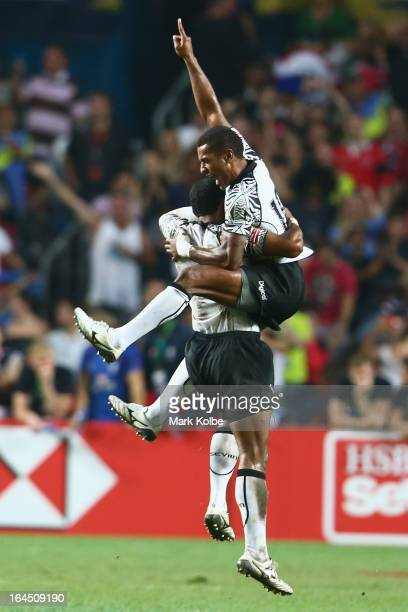 Samisoni Viriviri and Emosi Mulevoro of Fiji celebrate after winning the cup final match between Fiji and Wales during day three of the 2013 Hong...