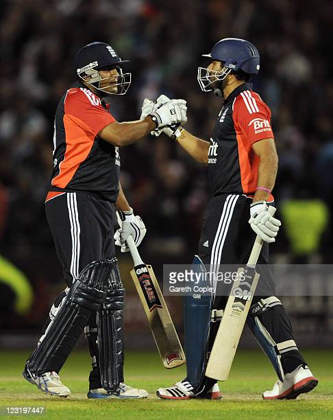 Samit Patel of England celebrates with Ravi Bopara after winning the NatWest International Twenty20 Match between England and India at Old Trafford...