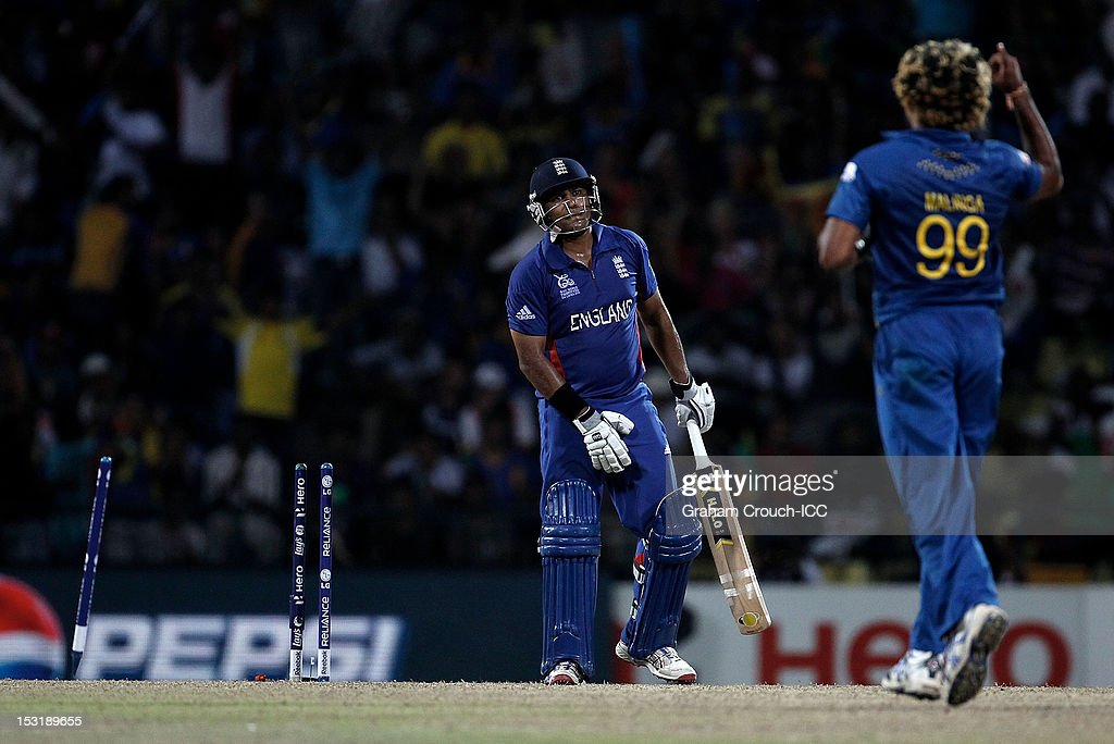 <a gi-track='captionPersonalityLinkClicked' href=/galleries/search?phrase=Samit+Patel&family=editorial&specificpeople=597936 ng-click='$event.stopPropagation()'>Samit Patel</a> of England is bowled by Lasith Malinga of Sri Lanka during the Super Eights Group 1 match between England and Sri Lanka at Pallekele Cricket Stadium on October 1, 2012 in Kandy, Sri Lanka.