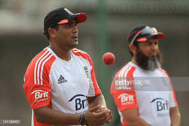 Samit Patel of England looks on with spin bowling coach Mushtaq Ahmed during the England nets session at the R Premadasa Stadium on March 12 2012 in...