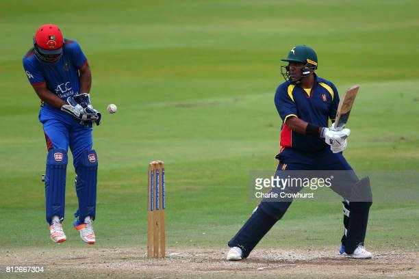 Samit Patel of MCC hits out while Afghanistan wicket keeper Shafiqullah Shafaq looks on during the MCC v Afghanistan cricket match at Lord's Cricket...