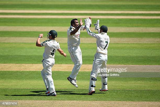 Samit Patel of Nottinghamshire celebrates with Chris Read and James Taylor after claiming the wicket of Richard Oliver of Worcestershire during day...