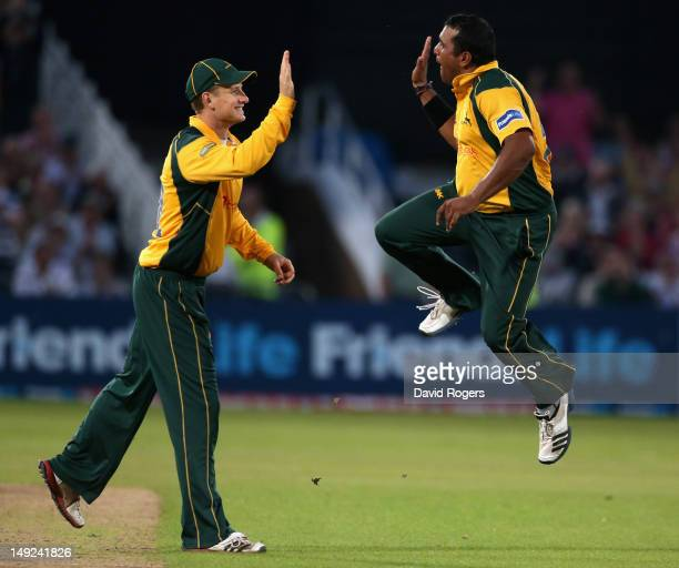 Samit Patel of Nottinghamshire celebrates with team mate Adam Voges after taking the wicket of Sean Ervine during the Friends Life T20 match between...