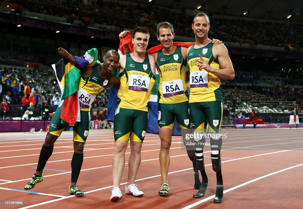 Samkelo Radebe, Zivan Smith, Arnu Fourie and <a gi-track='captionPersonalityLinkClicked' href=/galleries/search?phrase=Oscar+Pistorius&family=editorial&specificpeople=224406 ng-click='$event.stopPropagation()'>Oscar Pistorius</a> of South Africa celebrate winning gold in the Men's 4x100m relay T42/T46 Final on day 7 of the London 2012 Paralympic Games at Olympic Stadium on September 5, 2012 in London, England.
