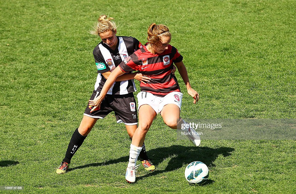 Sammara Schmitzer of the Jets attempts to tackle Louise Fors of the Wanderers during the round six W-League match between the Western Sydney Wanderers and the Newcastle Jets at Campbelltown Sports Stadium on November 25, 2012 in Sydney, Australia.