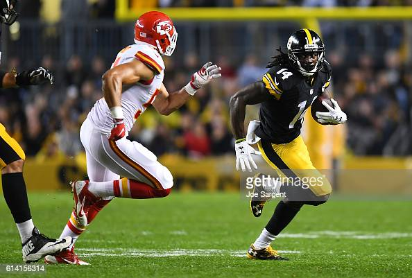 Sammie Coates of the Pittsburgh Steelers carries the ball in front of Frank Zombo of the Kansas City Chiefs at Heinz Field on October 2 2016 in...