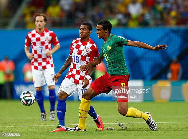 Sammir of Croatia and Joel Matip of Cameroon compete for the ball during the 2014 FIFA World Cup Brazil Group A match between Cameroon and Croatia at...