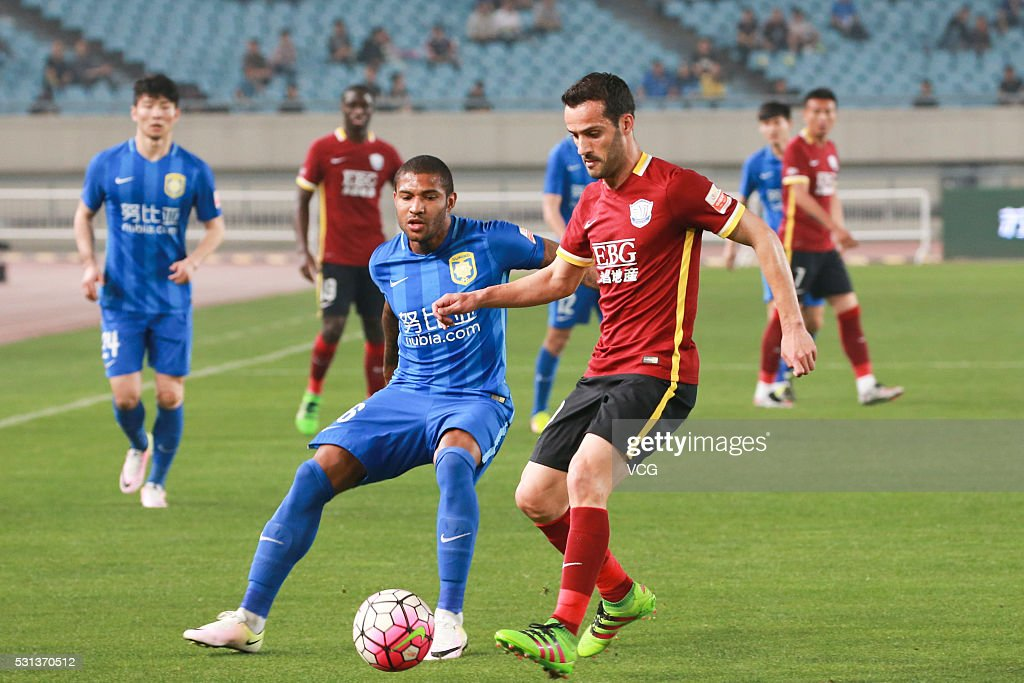 <a gi-track='captionPersonalityLinkClicked' href=/galleries/search?phrase=Sammir&family=editorial&specificpeople=4476204 ng-click='$event.stopPropagation()'>Sammir</a> #16 of Jiangsu Suning and <a gi-track='captionPersonalityLinkClicked' href=/galleries/search?phrase=Ruben+Micael&family=editorial&specificpeople=5848979 ng-click='$event.stopPropagation()'>Ruben Micael</a> #10 of Shijiazhuang Ever Bright compete for the ball during the Chinese Football Association Super League match between Jiangsu Suning and Shijiazhuang Ever Bright at Nanjing Olympic Sports Center on May 14, 2016 in Nanjing, China.