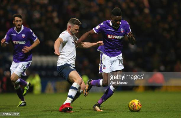 Sammy Ameobi of Bolton Wanderers beats Andy Boyle of Preston North End during the Sky Bet Championship match between Preston North End and Bolton...