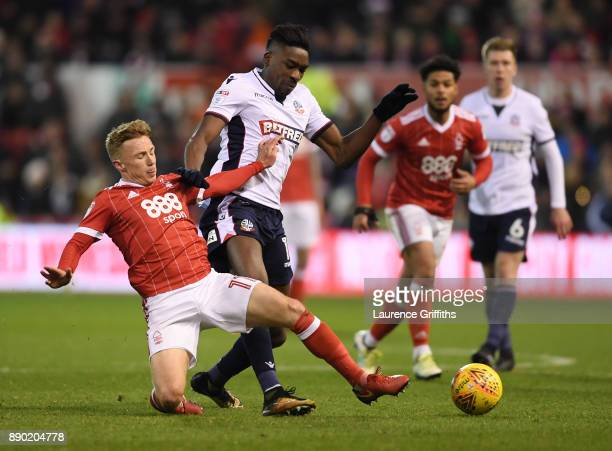 Sammy Ameobi of Bolton Wanderers is tackled by Ben Osborn of Nottingham Forest during the Sky Bet Championship match between Nottingham Forest and...