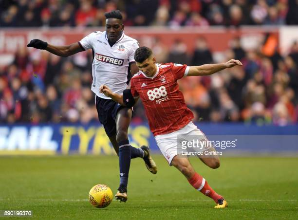 Sammy Ameobi of Bolton Wanderers is tackled by Eric Lichaj of Nottingham Forest during the Sky Bet Championship match between Nottingham Forest and...