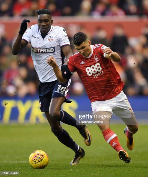 Sammy Ameobi of Bolton Wanderers is tackled by Eric Lichaj of Nottingham Forestduring the Sky Bet Championship match between Nottingham Forest and...