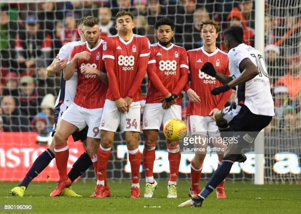 Sammy Ameobi of Bolton Wanderers takes a free kick as Darry Murphy Tyler Walker Liam Bridcutt and Kieran Dowell of Nottingham Forest line up in the...