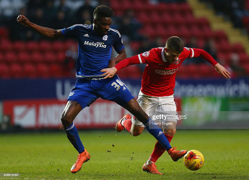 Sammy Ameobi of Cardiff (L) and Johann Gudmundsson of Charlton battle for the ball during the Sky Bet Championship match between Charlton Athletic and Cardiff City at The Valley on February 13, 2016 in London, United Kingdom.