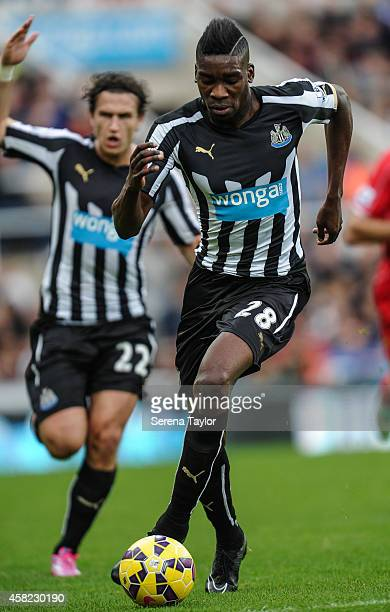 Sammy Ameobi of Newcastle runs with the ball during the Barclays Premier League match between Newcastle United and Liverpool at StJames' Park on...