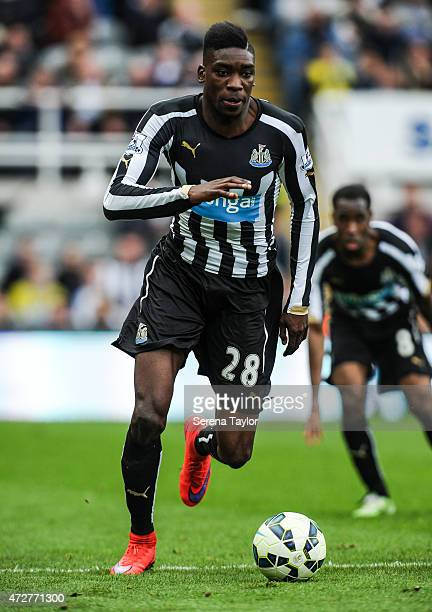 Sammy Ameobi of Newcastle runs with the ball during the Barclays Premier League match between Newcastle United and West Bromwich Albion at St James'...