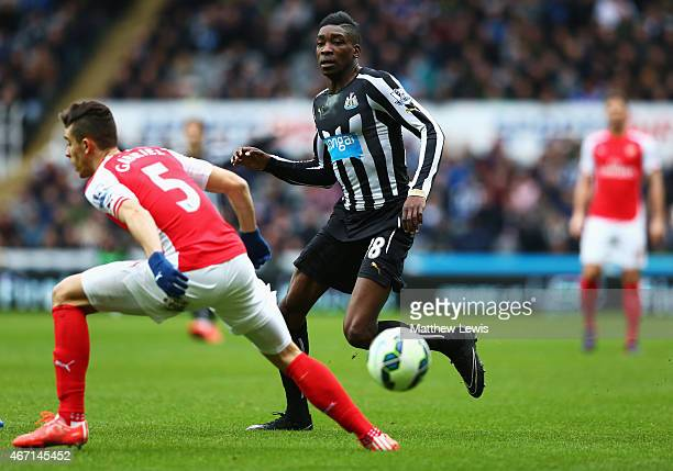 Sammy Ameobi of Newcastle United goes past Gabriel Paulista of Arsenal during the Barclays Premier League match between Newcastle United and Arsenal...