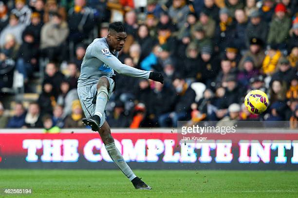 Sammy Ameobi of Newcastle United scores his team's second goal during the Barclays Premier League match between Hull City and Newcastle United at KC...