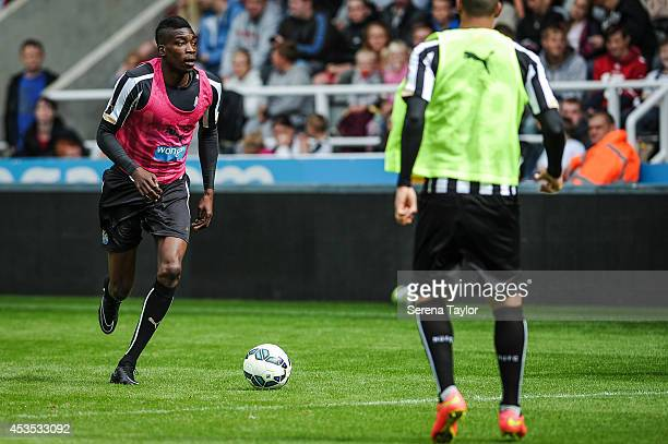 Sammy Ameobi runs with the ball during a Newcastle United Training Session at StJames' Park on August 12 in Newcastle upon Tyne England