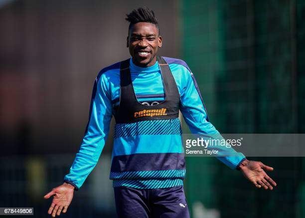 Sammy Ameobi smiles as he walks outside during the Newcastle United Training Session at The Newcastle United Training Centre on May 4 2017 in...