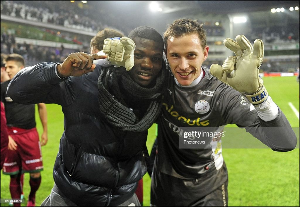 Sammy Bossut (SV Zulte Waregem) and Bernard Malanda-Adje (SV Zulte Waregem) celebrates the win with teammates in action during the Jupiler League match between RSC Anderlecht and SV Zulte Waregem on February 27, 2013 in Anderlecht, Belgium.