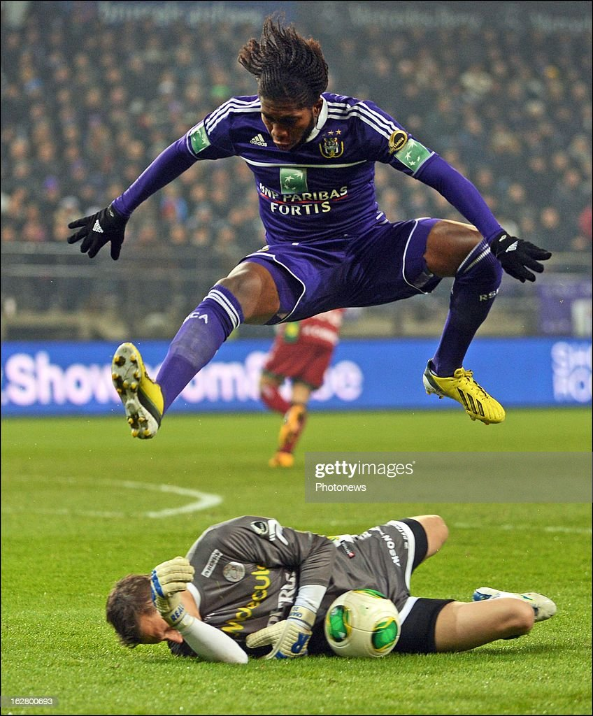 Sammy Bossut of SV Zulte Waregem and Mbokani Dieumerci of Rsc Anderlecht in action during the Jupiler League match between RSC Anderlecht and SV Zulte Waregem on February 27, 2013 in Anderlecht, Belgium.