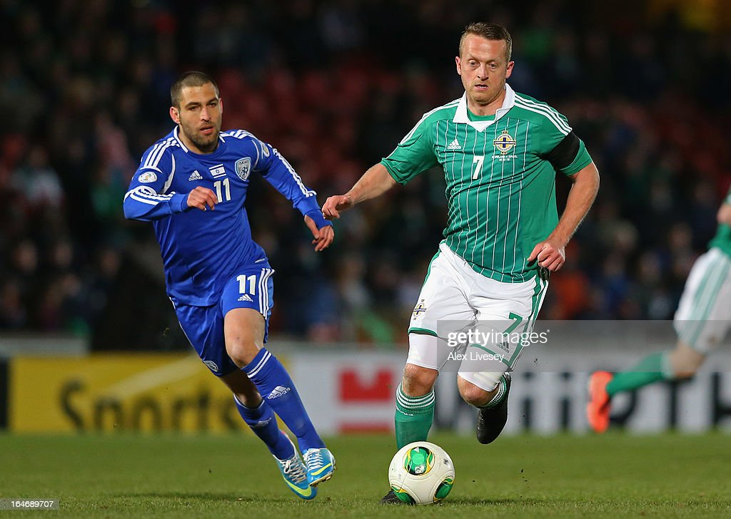 Sammy Clingan of Northern Ireland beats <a gi-track='captionPersonalityLinkClicked' href=/galleries/search?phrase=Itay+Shechter&family=editorial&specificpeople=5639928 ng-click='$event.stopPropagation()'>Itay Shechter</a> of Israel during the FIFA 2014 World Cup Group F Qualifier match between Northern Ireland and Israel at Windsor Park on March 26, 2013 in Belfast, Northern Ireland.