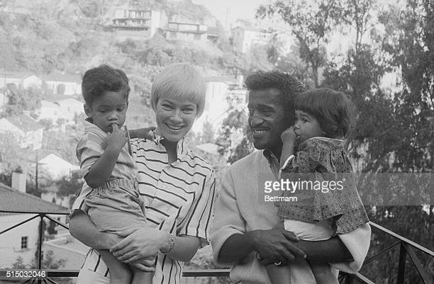 Sammy Davis Jr and Family Hollywood California Versatile entertainer Sammy Davis Jr and his wife actress May Britt pose with their newly enlarged...