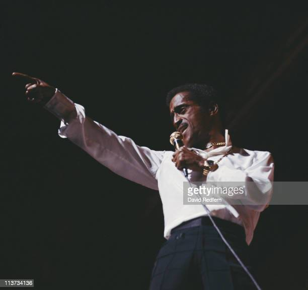 Sammy Davis Jr US singer dancer and actor singing into a microphone during a live concert performance at the Palladium in London England Great...