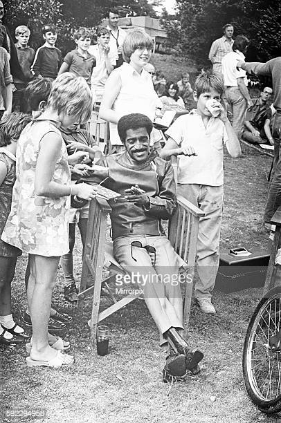 Sammy Davis Junior signing autographs whilst on location of 'One More Time' at Eastnor Castle Ledbury Circa 1st August 1969
