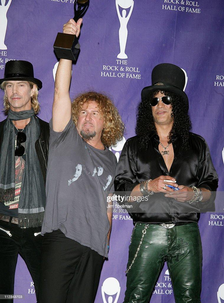 Sammy Hagar of Van Halen, inductee (center), with Duff McKagan and Slash of Velvet Revolver, presenters