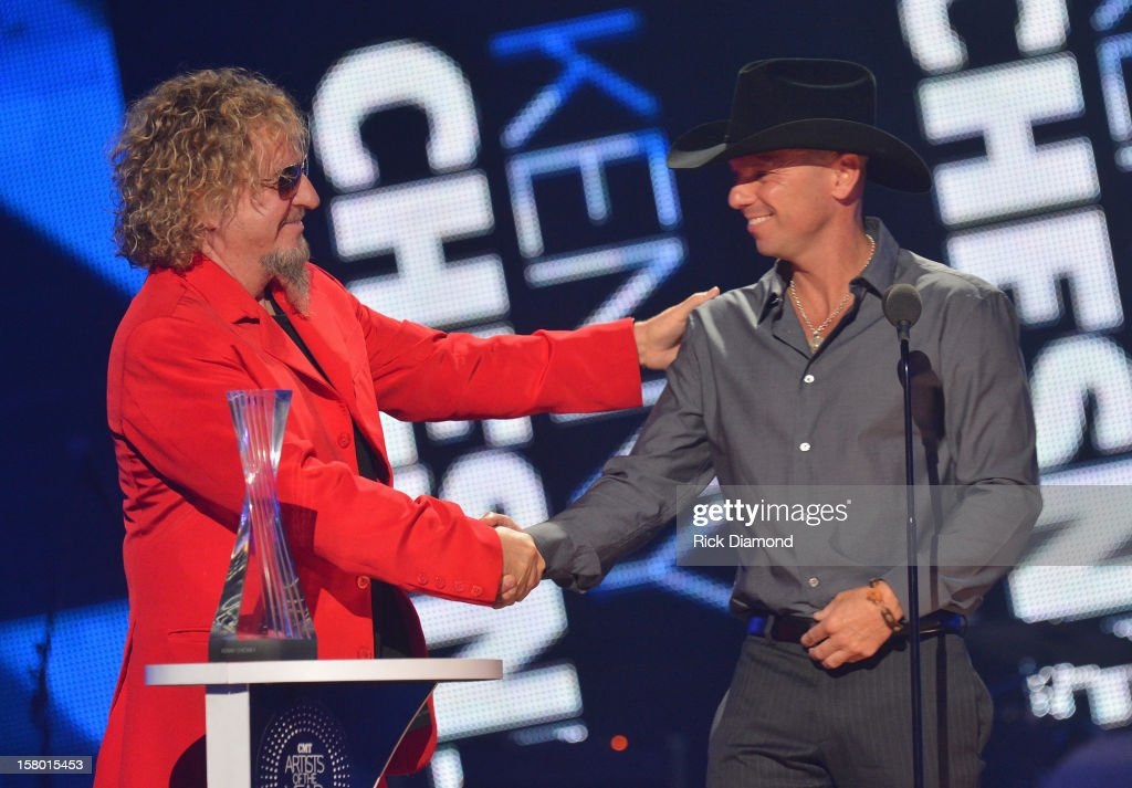 Sammy Hagar presents award to Kenny Chesney onstage during the 2012 CMT Artists Of The Year at The Factory at Franklin on December 3 2012 in Franklin...